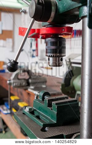 stationary professional drilling machine in a workshop