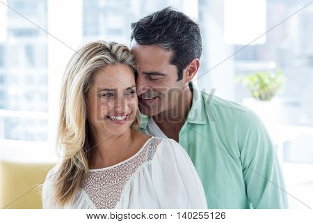 Front view of mid adult romantic couple at home