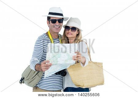 Front view of couple reading map against white background