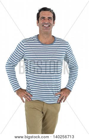 Mid adult man with hand on hip standing against white background