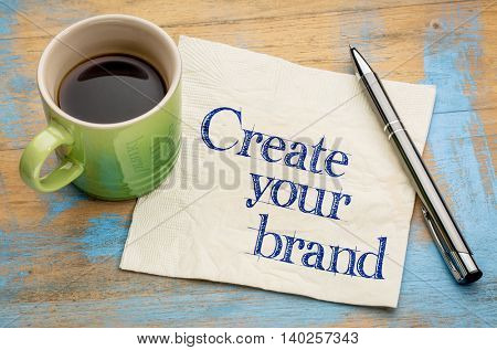 Create your brand advice - handwriting on a napkin with a cup of espresso coffee