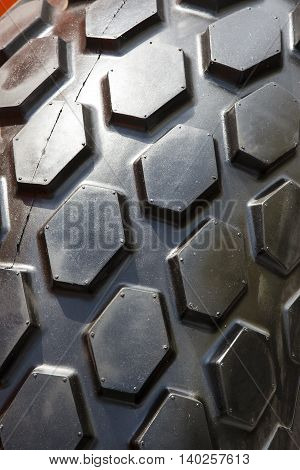 Background of a rubber wheel spikes shot closeup