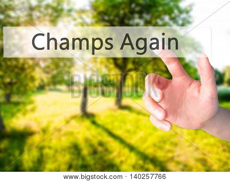 Champs Again - Hand Pressing A Button On Blurred Background Concept On Visual Screen.