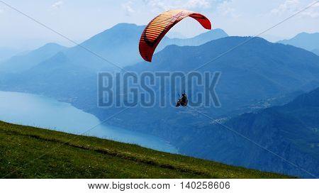 Paraglider at Monte Baldo, over the Lake Garda