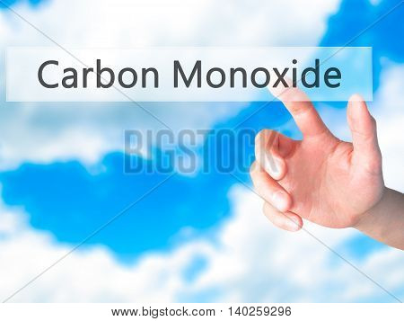 Carbon Monoxide - Hand Pressing A Button On Blurred Background Concept On Visual Screen.