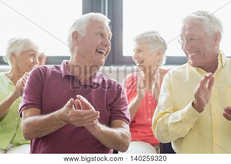 Seniors clapping hands in a retirement home