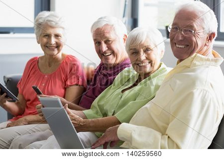 Seniors using tablets in a retirement home