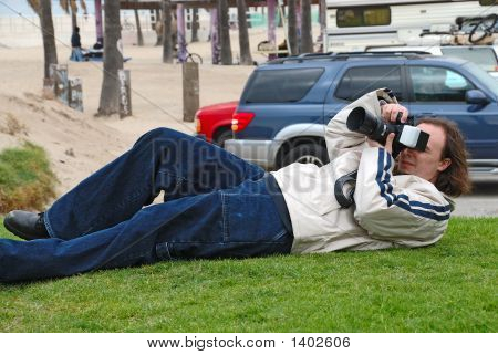 Photographer Shooting From A Different Perspective