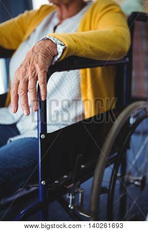 Close-up of a hand of a senior woman in a wheelchair