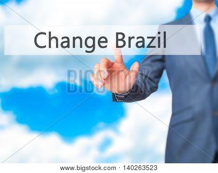 Change Brazil -  Businessman Press On Digital Screen.
