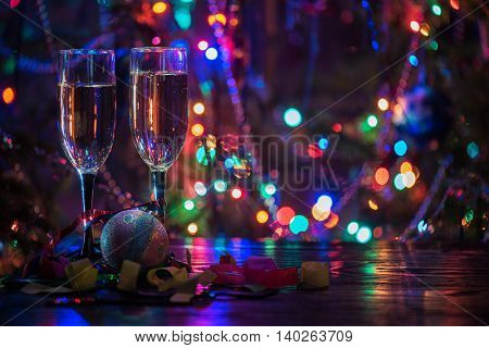 two shampagne glasses on celebratory table