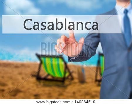 Casablanca  -  Businessman Press On Digital Screen.