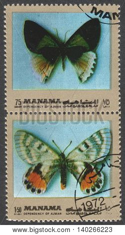 MOSCOW RUSSIA - CIRCA FEBRUARY 2016: a post stamp printed in Ajman shows butterflies the series