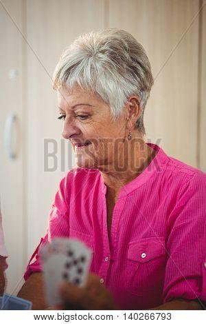 Side of a senior woman wearing pink shirt