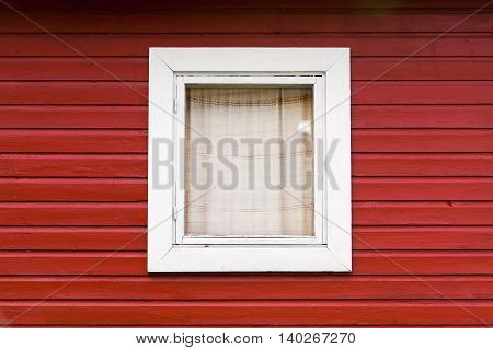 Red Wooden Wall With Small Window