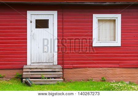 White Closed Door And Window In Red Wall