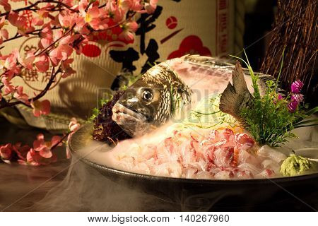 Plate of fresh sliced sushi from grouper fish in Japanese restaurant
