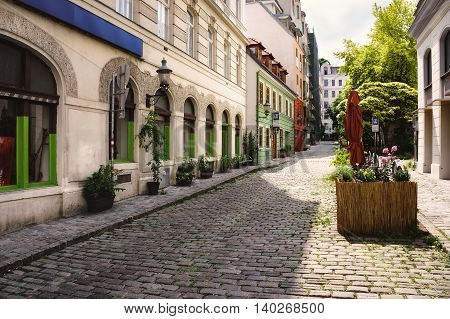Nice cozy street in the old town of Vienna at sunny summer day, Austria