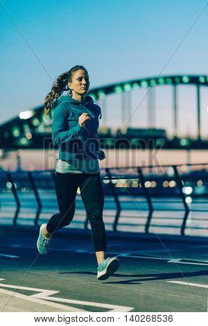 Jogging on riverside, toned image, vertical image