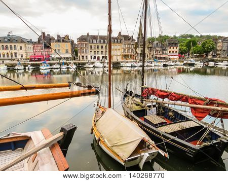Fishing boats in the old port of Honfleur at sunrise. Normandy, France