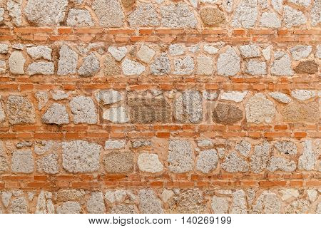 Ancient stone and brick work in horizontal orderStone part of the wall