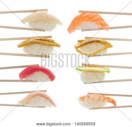 Sushi Nigiri Set In Bamboo Chopsticks Isolated On White Background