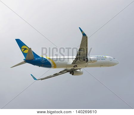 Borispol Ukraine - October 2 2011: Ukraine International Airlines Boeing 737-800 is taking off into cloudy sky with its gear already retracted