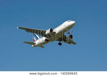 Borispol Ukraine - June 9 2011: Air France Airbus A319 is landing against blue sky in summer