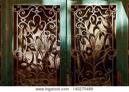 Wrought Iron Door with a straightforward design and shabby frame