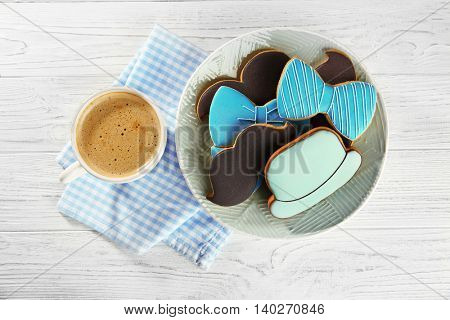 Happy Father's Day concept. Tasty cookies and cup of coffee on wooden background