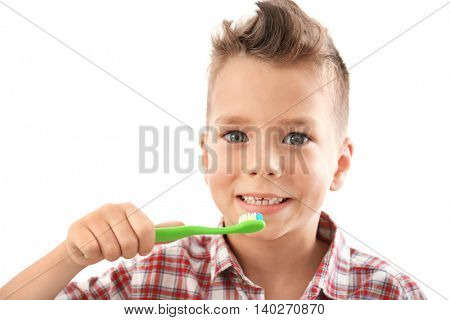 Cute boy with toothbrush isolated on white