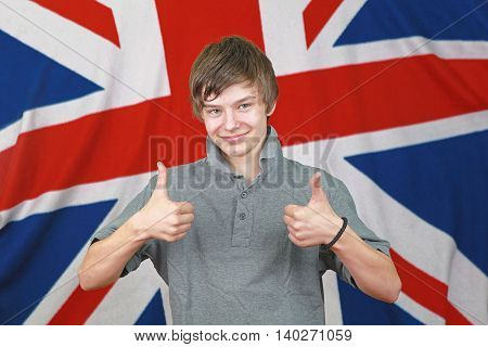 Young British Boy Two Thumbs up in Front of Union Jack Flag