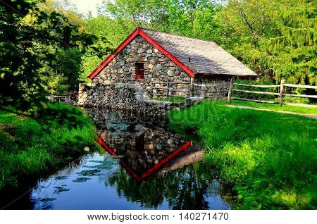 Sudbury Massachusetts - July 12 2013: The Old Stone Grist Mill still grinds flour for nearby Longfellow's 1716 Wayside Inn *