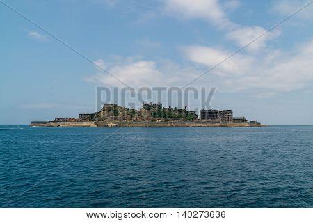 Gunkanjima (Hashima Island) in Nagasaki, Japan. Gunkanjima (meaning Battleship Island), is former coal mining island.  The island was formally approved as UNESCO World Heritage side in July 2015.