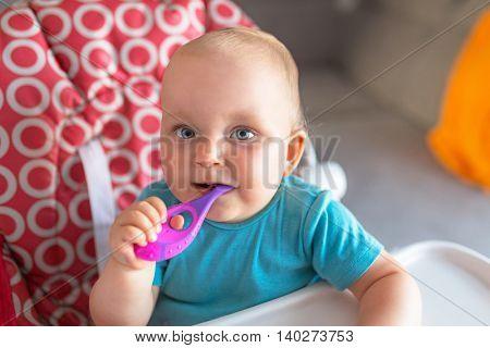 Cute baby girl brushing teeth