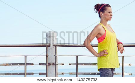 Fitness Woman Looking Into Distance And Listening To The Music