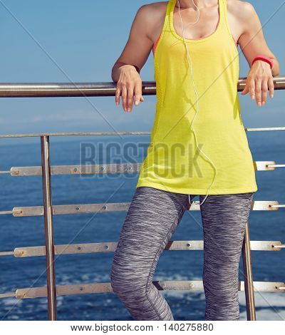 Young Healthy Woman Relaxing After Workout At Embankment