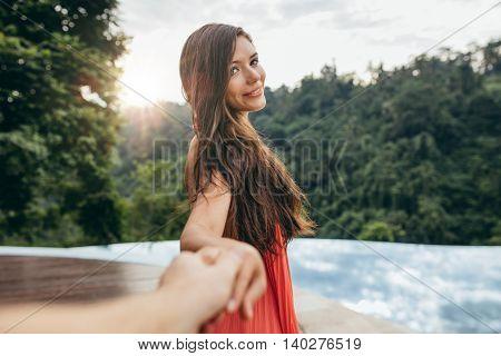 Beautiful Girlfriend Leading Man To Swimming Pool