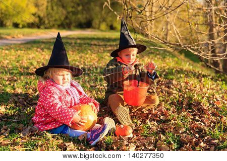 kids in halloween costume play at autumn park, kids trick or treating
