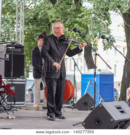 St. Petersburg, Russia - 23 July, Maestro violin at the microphone, 23 July, 2016. Speech by David Goloschekin with his jazz group on the Arts Square in St. Petersburg.