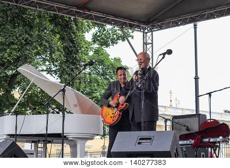 St. Petersburg, Russia - 23 July, Musicians with a guitar and a violin, 23 July, 2016. Speech by David Goloschekin with his jazz group on the Arts Square in St. Petersburg.