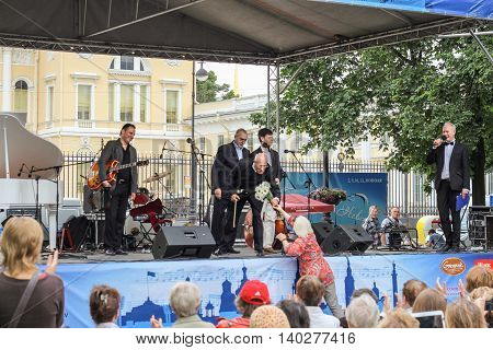 St. Petersburg, Russia - 23 July, The maestro accepts congratulations, 23 July, 2016. Speech by David Goloschekin with his jazz group on the Arts Square in St. Petersburg.