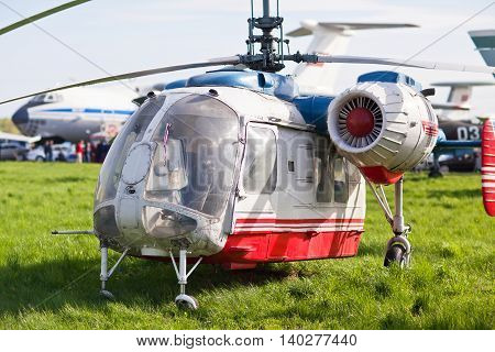 Russian helicopter standing on the grass with the engine OFF.