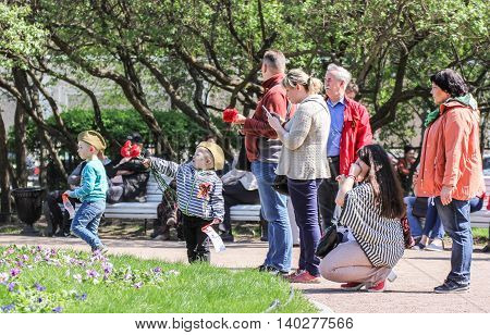 St. Petersburg, Russia - 9 May, Big family in the garden, 9 May, 2016. Vacationers people on the lawns and gardens in the city.