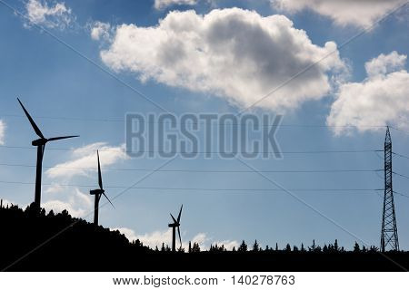 Windmills for electric power production at sunset, Huesca Province, Aragon, Spain