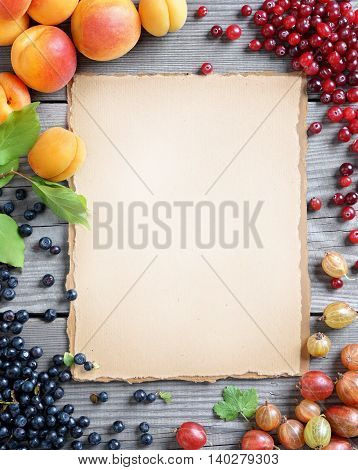 Organic food background. Photography of fresh cranberry bilberry gooseberry and apricots on wooden table. Top view high resolution product.