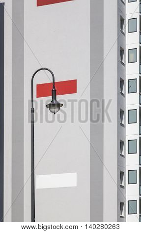 street light with plattenbau in background and design