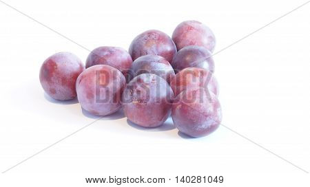 Ripe plums lying on a white background