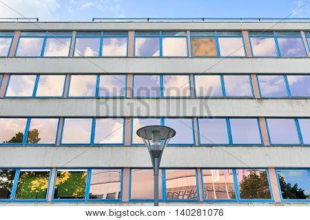Facade Of An Office Building With Orange And Blue Windows