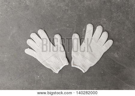 Gloves made of white, fabric for use in industrial applications.